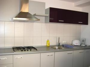 O bucătărie sau chicinetă la Vila Malva