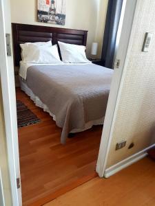 Cama o camas de una habitación en Central Apartment Santiago BYP