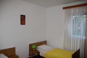 A bed or beds in a room at Sandra