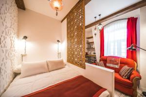 Кровать или кровати в номере Revelton Studios Baku