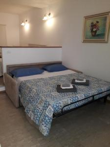 A bed or beds in a room at Casa Vacanze Zia Maria