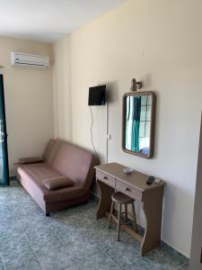 A television and/or entertainment center at Galini Apartments