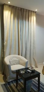 A bed or beds in a room at Nozul Al Tout Furnished Apartments