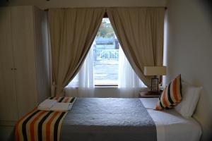 A bed or beds in a room at Selknam