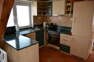 Kuchyň nebo kuchyňský kout v ubytování Apartmán Na bidýlku