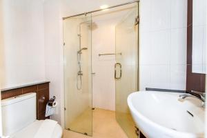 A bathroom at The Nice Condotel by RUS THAI Property