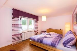 Ein Bett oder Betten in einem Zimmer der Unterkunft Ferienhaus Thom