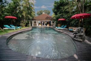 The swimming pool at or near The Secret Jungle Villas by Premier Hospitality Asia