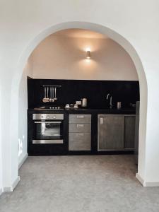 A cozinha ou cozinha compacta de Il Dammusino di Pantelleria