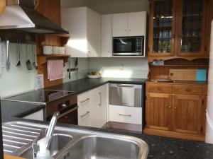 A kitchen or kitchenette at Manly Beach Family Holiday Home
