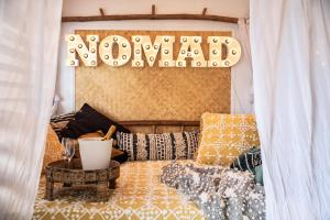 A bed or beds in a room at NOMAD - Luxe apartment