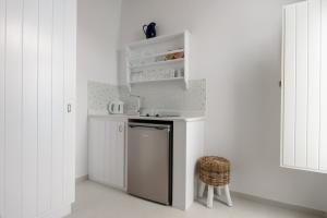 A kitchen or kitchenette at Vallas Apartments & Villas