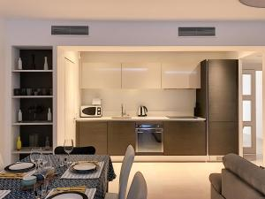 A kitchen or kitchenette at Incredible views of Nice in a calm luxury complex