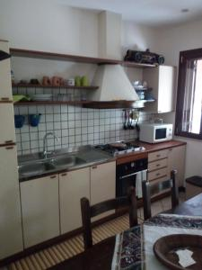 Kuhinja ili čajna kuhinja u objektu Villa Cristina