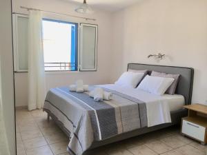 Ένα ή περισσότερα κρεβάτια σε δωμάτιο στο Noe Rooms