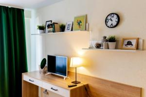 A television and/or entertainment center at OpenApart - Family nest
