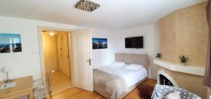 Cama ou camas em um quarto em Boël 5