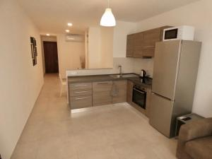 A kitchen or kitchenette at Bugibba 1 Bedroom Apartment