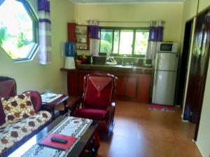 A kitchen or kitchenette at Siargao Sunset Bay Beach Villas