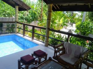 A view of the pool at Siargao Sunset Bay Beach Villas or nearby