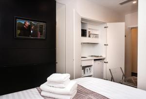 Ένα ή περισσότερα κρεβάτια σε δωμάτιο στο MStay Golders Green
