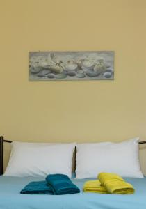 A bed or beds in a room at Central Spacious Apartment