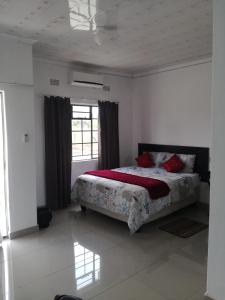 A bed or beds in a room at Looks cottages self catering apartments