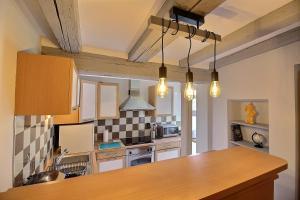 Küche/Küchenzeile in der Unterkunft LE PTIT BARTHO