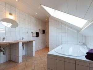 A bathroom at Serene apartment in Weeze with private garden