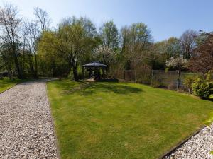 A garden outside Serene apartment in Weeze with private garden