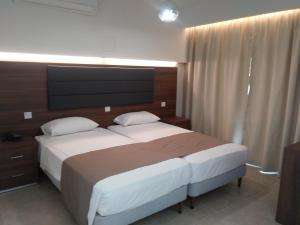 A bed or beds in a room at Livas Hotel Apartments