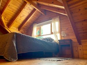 Una cama o camas en una habitación de Departamentos turismo