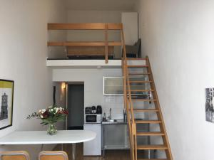 A kitchen or kitchenette at Brussels City Center Apartments