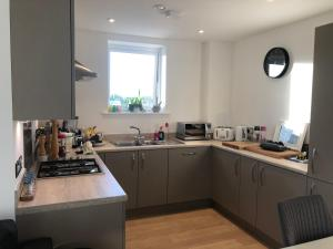 A kitchen or kitchenette at Huge Penthouse 2 bed, 2 bathroom apartment / 5 mins to Gatwick Airport