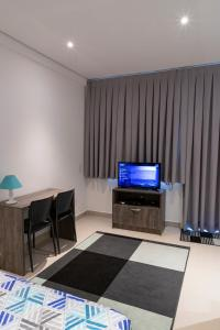 A television and/or entertainment center at K Residence