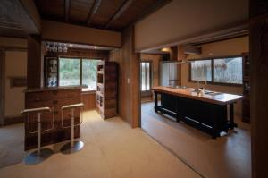 A bathroom at Miyama Futon & Breakfast Thatched Cottages