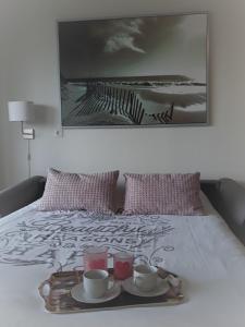 Ein Bett oder Betten in einem Zimmer der Unterkunft StudioWestdiep
