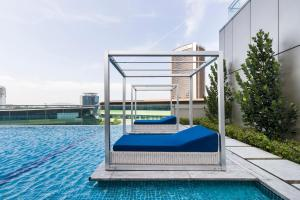 The swimming pool at or close to KL Central Luxury Apartment by GuestReady