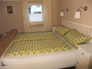 Ein Bett oder Betten in einem Zimmer der Unterkunft Allgäu Apartment