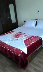 A bed or beds in a room at Hotel Melungtse