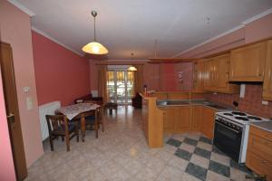 A kitchen or kitchenette at Angela Apartments Studios