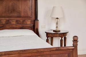 Un ou plusieurs lits dans un hébergement de l'établissement Palazzo Contarini Della Porta Di Ferro