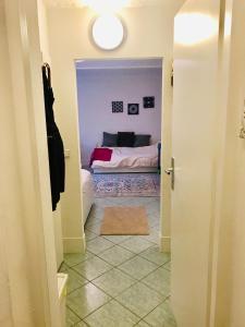 Säng eller sängar i ett rum på City Hideaway with Terrace