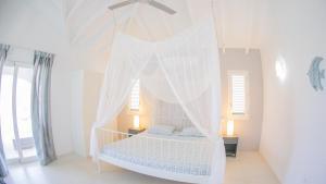 Een bed of bedden in een kamer bij Villa Nautilus