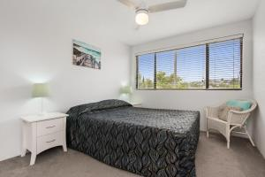 A bed or beds in a room at Alexandria Apartments