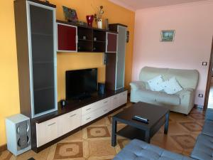 A television and/or entertainment center at Piso Naron