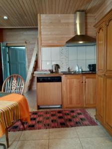 A kitchen or kitchenette at Guest House Pītagi