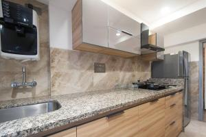 A kitchen or kitchenette at Orbit Home Luxury Service Apartments