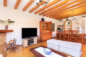 A television and/or entertainment center at HomeLike Luxury Villa Luna de Tacoronte Pool