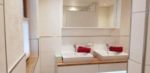 Ein Badezimmer in der Unterkunft Ferienwohnung Langwallner